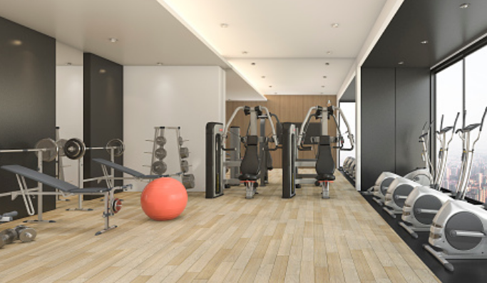fitness center at Dartmoor Place at Oxford Square apartments in Hanover MD with various exercise machines and spin bikes